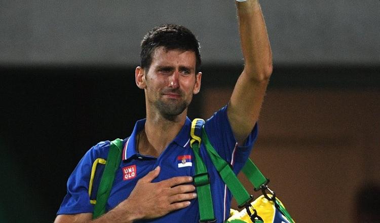 Les larmes de Djokovic après sa défaite contre Del Potro aux Jeux Olympiques. Une image forte des J.O. (AFP/Roberto SCHMIDT)