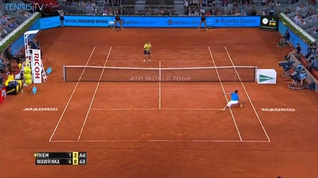 Dominic Thiem s'arrache pour breaker Stan Wawrinka au Masters 1000 de Madrid 2014.
