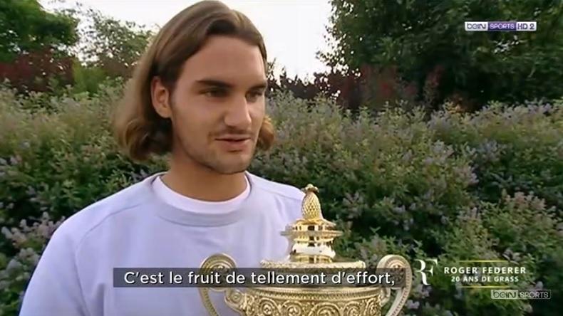 Roger Federer, après son premier titre à Wimbledon en 2003. Coupe de beau gosse.