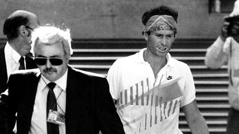John McEnroe est disqualifié en huitièmes de finale de l'Open d'Australie 1990. (News Limited)
